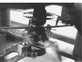 Spring control in an instrument